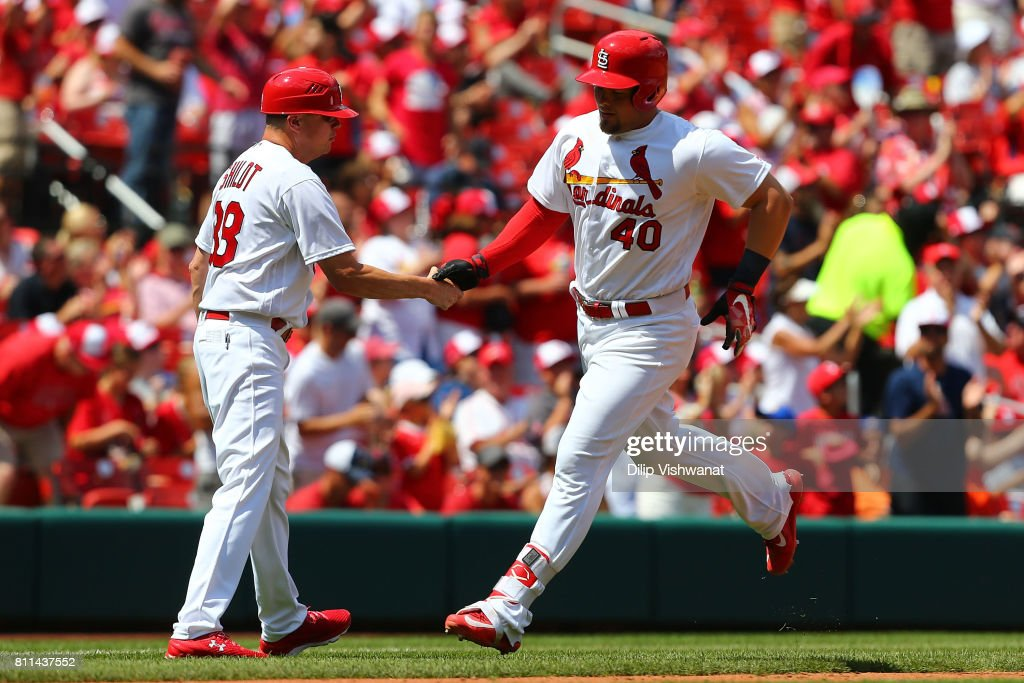 Mike Shildt #38 of the St. Louis Cardinals congratulates Luke Voit #40 of the St. Louis Cardinals after Voit hit a home run against the New York Mets in the sixth inning at Busch Stadium on July 9, 2017 in St. Louis, Missouri.