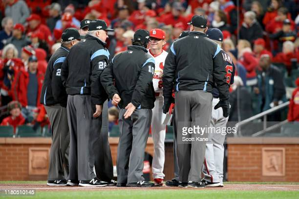 Mike Shildt of the St Louis Cardinals talks with the officials prior to game one of the National League Championship Series against the Washington...