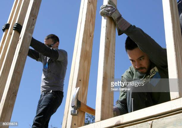 Mike Shinoda and Chester Bennington of the band Linkin Park build a house frame together as they work with Music for Relief and Habitat for Humanity...