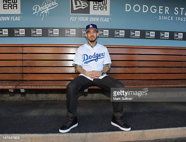 Mike Shinoda of the band Linkin Park in the dugout at Dodger Stadium on June 29 2012 in Los Angeles California