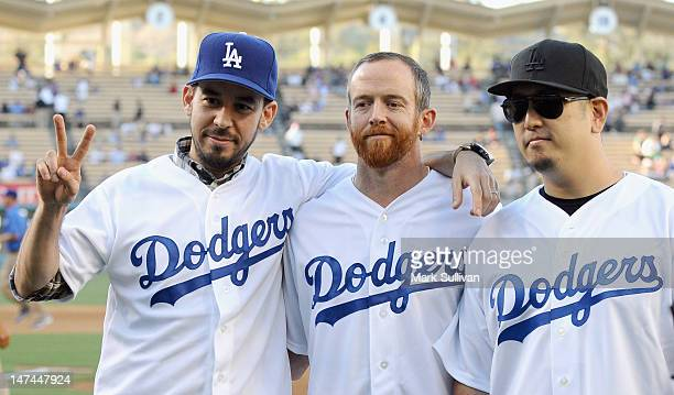 Mike Shinoda Phoenix Farrell and Joe Hahn of the band Linkin Park on the field at Dodger Stadium on June 29 2012 in Los Angeles California