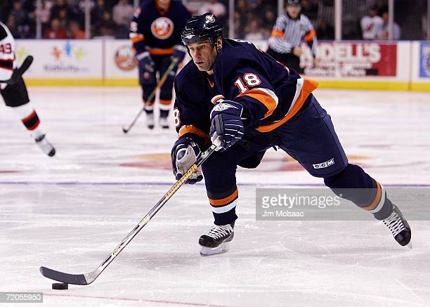 Mike Sillinger of the New York Islanders reaches for the puck against the New Jersey Devils during their NHL preseason game on September 30 2006 at...