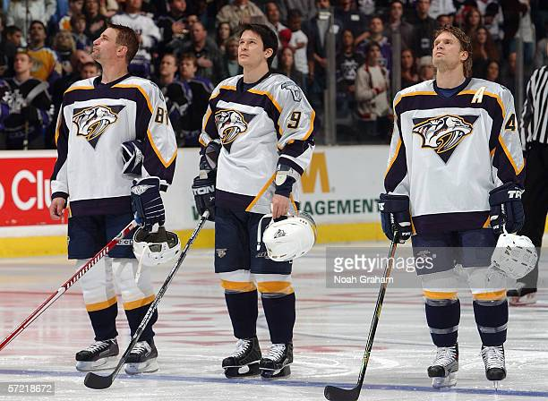 Mike Sillinger Paul Kariya and Kimmon Timonen of the Nashville Predators line up at the blueline prior to their game against the Los Angeles Kings on...