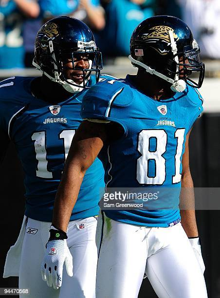 Mike SimsWalker and Torry Holt of the Jacksonville Jaguars look over the defense during the game against the Houston Texans at Jacksonville Municipal...