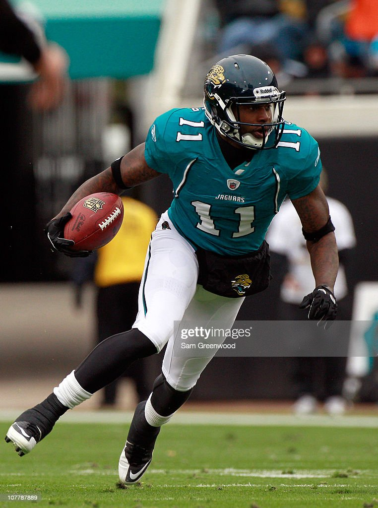 Mike Sims-Walker #11 of the Jacksonville Jaguars runs for yardage during the game against the Washington Redskins at EverBank Field on December 26, 2010 in Jacksonville, Florida.