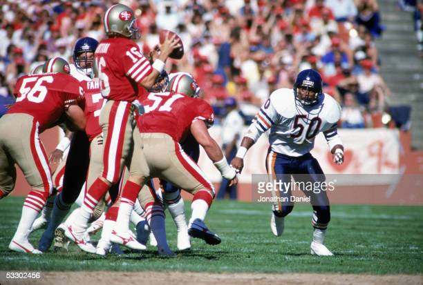 Mike Singletary of the Chicago Bears pass rushes Joe Montana of the San Francisco 49ers during the game at Candlestick Park on October 13 1985 in...