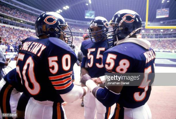 Mike Singletary Otis Wilson and Wilber Marshall of the Chicago Bears stand on the sideline before the game against the Dallas Cowboys at Texas...