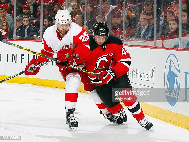 Mike Sislo of the New Jersey Devils and Mike Green of the Detroit Red Wings  battle f82f936ad