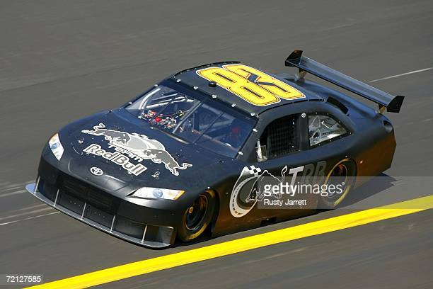Mike Skinner, driver of the Red Bull Toyota, drives the low groove during NASCAR car of tomorrow testing at Talladega Superspeedway on October 9,...