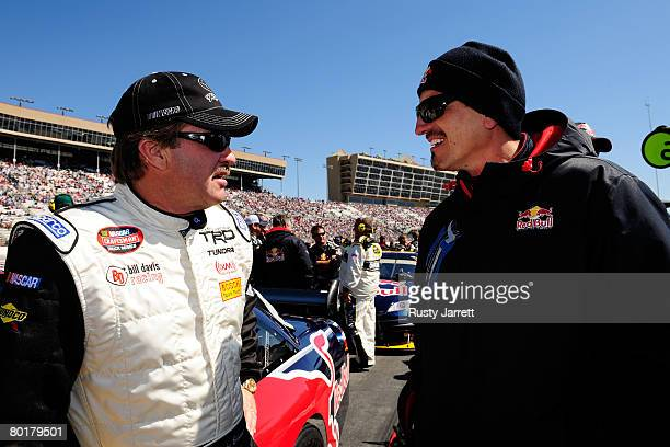 Mike Skinner driver of the Red Bull Toyota speaks with Gunther Steiner Technical Director for Red Bull Racing Team prior to the NASCAR Sprint Cup...