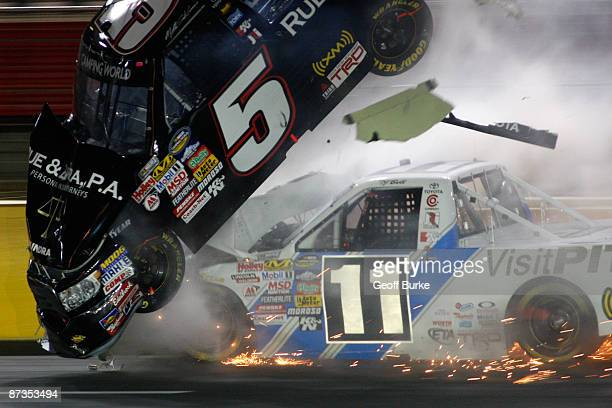 Mike Skinner driver of the Rue Ziffra PA Attorney at Law Toyota flies into the air on the hood of TJ Bell driver of the VisitPITcom/Red Horse Racing...