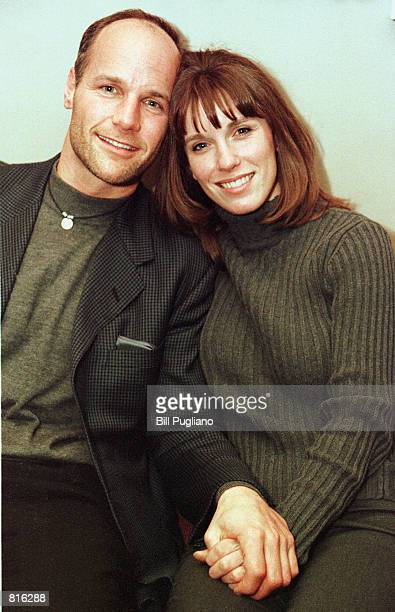 """Mike Skupin, a cast member on the second season of the hit television show """"Survivor"""" sits with his wife Peni March 10, 2001 following a talk at..."""