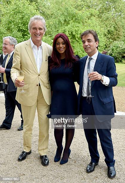 Mike Slade Phoebe Vela Hitchcox and James Henderson attend The Bell Pottinger Summer Party at Lancaster House on June 7 2016 in London England