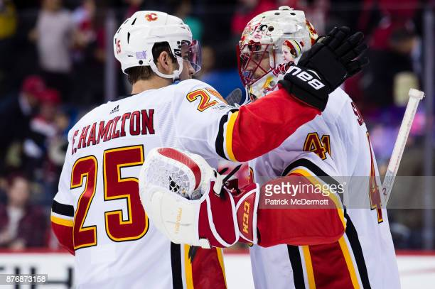 Mike Smith and Freddie Hamilton of the Calgary Flames celebrate after the Flames defeated the Washington Capitals 41 at Capital One Arena on November...
