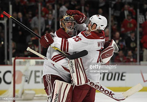 Mike Smith and Ray Whitney of the Phoenix Coyotes celebrate a win against the Chicago Blackhawks in Game Three of the Western Conference...