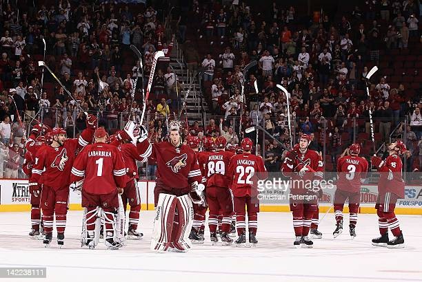 Mike Smith and the Phoenix Coyotes acknowledge the fans after defeating the Anaheim Ducks in the NHL game at Jobing.com Arena on March 31, 2012 in...