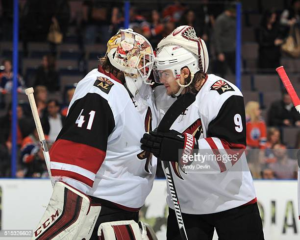 Mike Smith and Viktor Tikhonov of the Arizona Coyotes celebrate after winning the game against the Edmonton Oilers on March 12 2016 at Rexall Place...