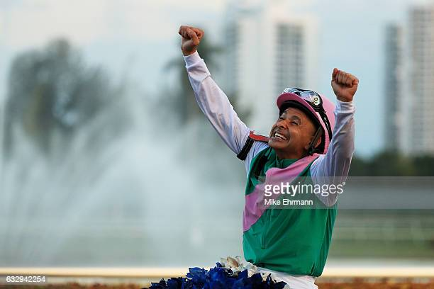 Mike Smith atop Arrogate celebrates after winning the $12 Million Pegasus World Cup Invitational at Gulfstream Park on January 28 2017 in Hallandale...