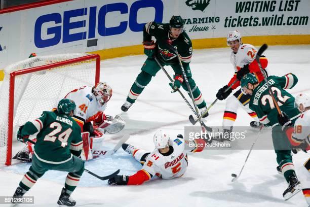 Mike Smith Mark Giordano and Travis Hamonic of the Calgary Flames defend against Matt Dumba Mikko Koivu and Nino Niederreiter of the Minnesota Wild...