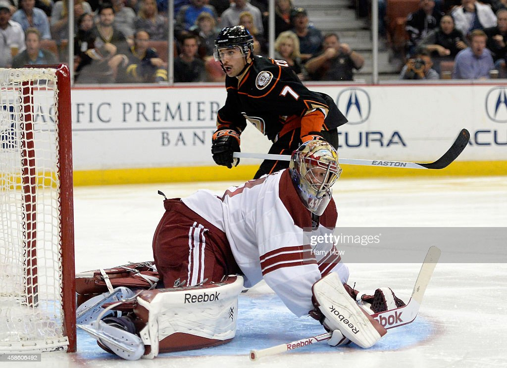 Mike Smith #41 of the Arizona Coyotes and Andrew Cogliano #7 of the Anaheim Ducks reacts to a missed shot during the third period at Honda Center on November 7, 2014 in Anaheim, California.