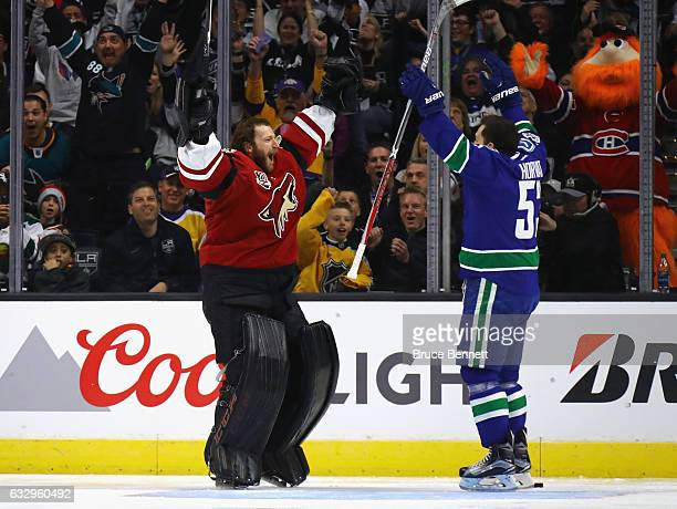 Mike Smith of the Arizona Coyotes celebrates with Bo Horvat of the Vancouver Canucks after Smith made his shot during the Honda NHL Four Line...