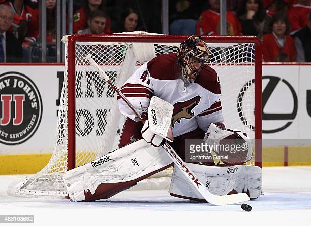 Mike Smith of the Arizona Coyotes makes a save against the Chicago Blackhawks at the United Center on February 9 2015 in Chicago Illinois The Coyotes...