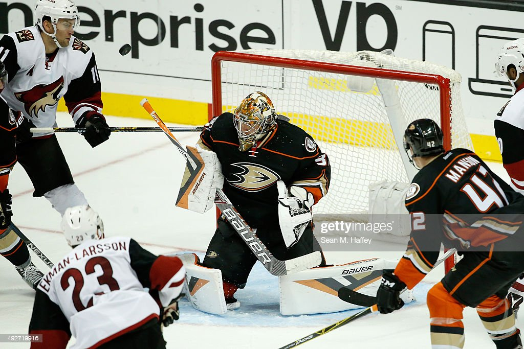 Mike Smith #41 of the Arizona Coyotes prepares to block a shot as Martin Hanzal #11 of the Arizona Coyotes, Oliver Ekman-Larsson #23 of the Arizona Coyotes and Josh Manson #42 of the Anaheim Ducks skate during a game at Honda Center on October 14, 2015 in Anaheim, California.