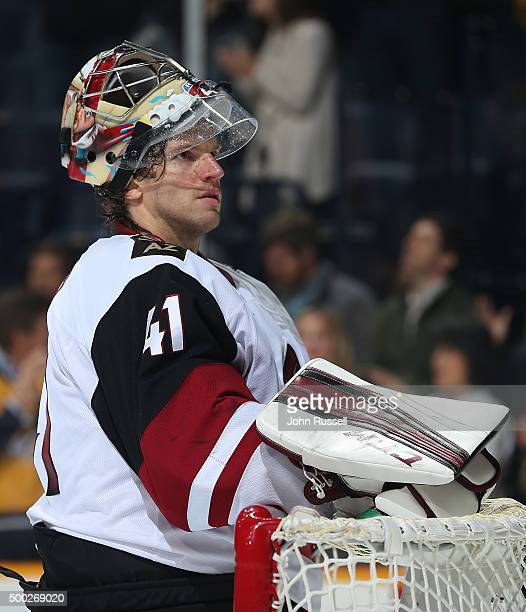 Mike Smith of the Arizona Coyotes tends net against the Nashville Predators during an NHL game at Bridgestone Arena on December 1 2015 in Nashville...