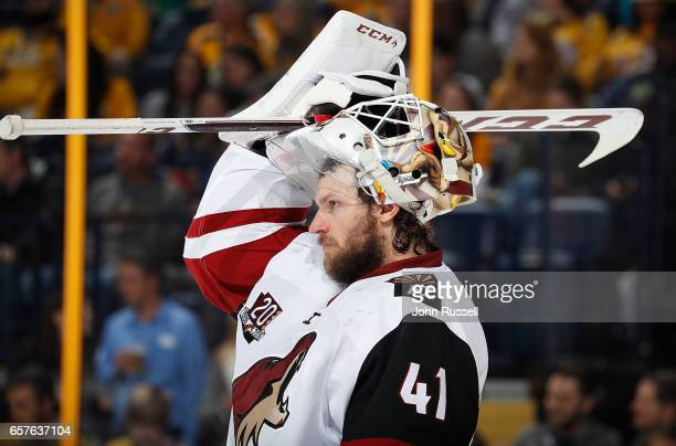 Mike Smith of the Arizona Coyotes tends net against the Nashville Predators during an NHL game at Bridgestone Arena on March 20 2017 in Nashville...