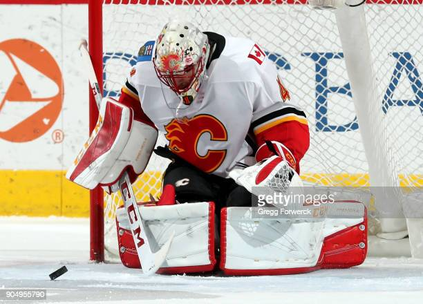 Mike Smith of the Calgary Flames blocks a Carolina Hurricanes shot during an NHL game on January 14 2018 at PNC Arena in Raleigh North Carolina
