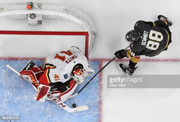 Mike Smith of the Calgary Flames blocks a shot by Nate Schmidt of the Vegas Golden Knights in the first period of their game at TMobile Arena on...