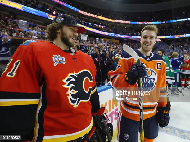 Mike Smith of the Calgary Flames chats with Connor McDavid of the Edmonton Oilers during the 2018 GEICO NHL AllStar Skills Competition at Amalie...