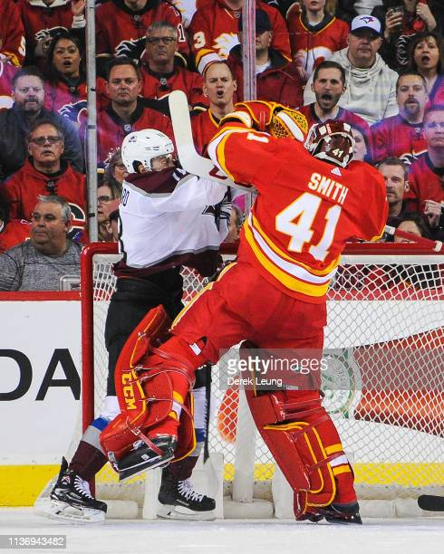 Mike Smith of the Calgary Flames fights Derick Brassard of the Colorado Avalanche during play in Game Two of the Western Conference First Round...