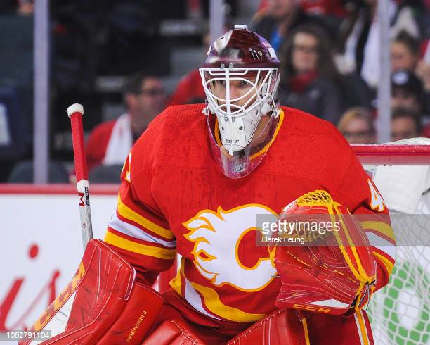 Mike Smith of the Calgary Flames in action against the Vancouver Canucks during an NHL game at Scotiabank Saddledome on October 6 2018 in Calgary...