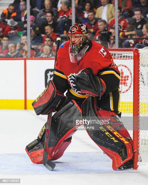 Mike Smith of the Calgary Flames in action Ottawa Senators during an NHL game at Scotiabank Saddledome on October 13 2017 in Calgary Alberta Canada