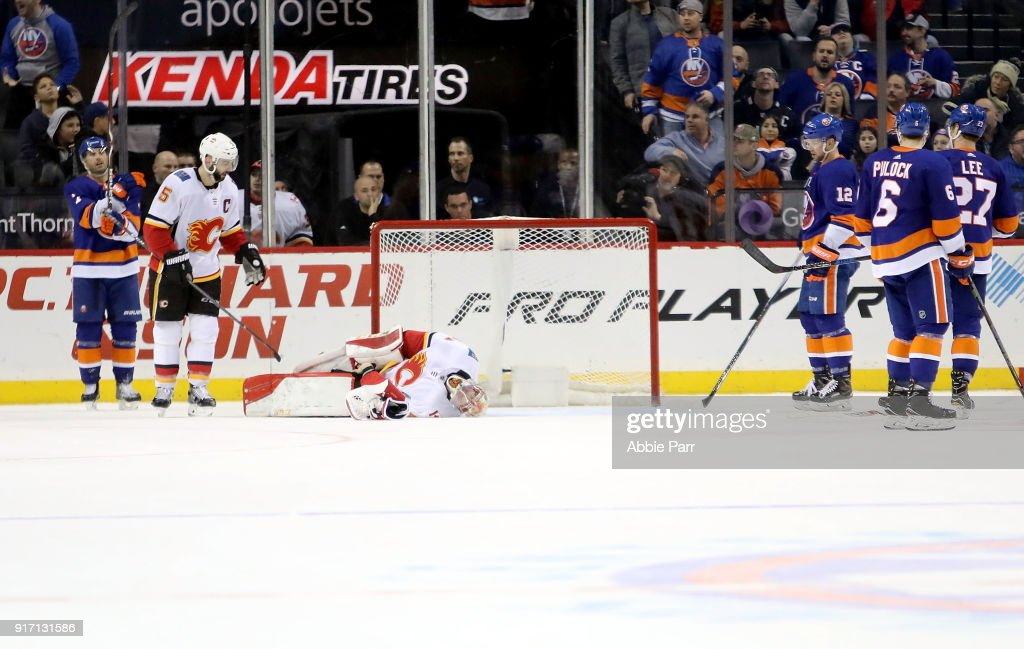 Mike Smith #41 of the Calgary Flames lays on the ground after being injured with 1.1 seconds left in the third period against the New York Islanders during their game at Barclays Center on February 11, 2018 in the Brooklyn borough of New York City.
