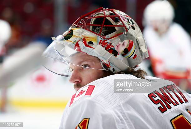 Mike Smith of the Calgary Flames looks on from the bench during their NHL game against the Vancouver Canucks at Rogers Arena February 9 2019 in...