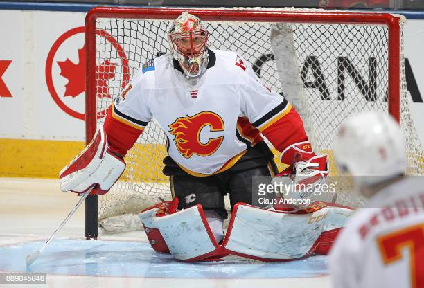 Mike Smith of the Calgary Flames looks to face a shot during the warmup prior to playing against the Toronto Maple Leafs in an NHL game at the Air...