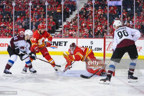 Mike Smith of the Calgary Flames makes a glove save on a shot from Gabriel Landeskog of the Colorado Avalanche in Game One of the Western Conference...