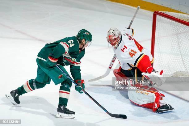 Mike Smith of the Calgary Flames makes a save against Mikael Granlund of the Minnesota Wild during the game at the Xcel Energy Center on January 9...