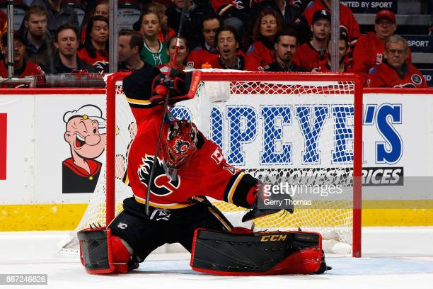 Mike Smith of the Calgary Flames makes a save against the Dallas Stars during an NHL game on October 27 2017 at the Scotiabank Saddledome in Calgary...