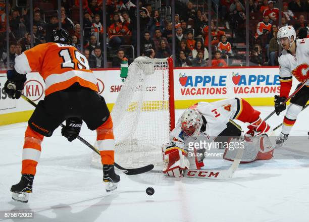 Mike Smith of the Calgary Flames makes the second period save on Nolan Patrick of the Philadelphia Flyers at the Wells Fargo Center on November 18...