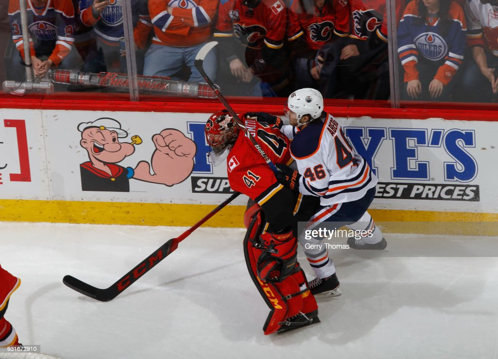 Mike Smith #41 of the Calgary Flames plays the puck against the Edmonton Oilers at Scotiabank Saddledome on March 13, 2018 in Calgary, Alberta, Canada.