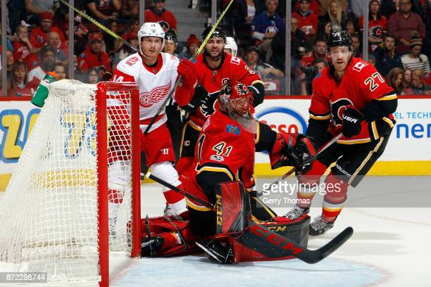 Mike Smith of the Calgary Flames reacts to a shot by the Detroit Red Wings during an NHL game on November 9 2017 at the Scotiabank Saddledome in...