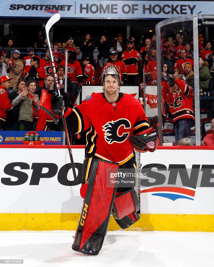 Mike Smith of the Calgary Flames salutes the crowd after his