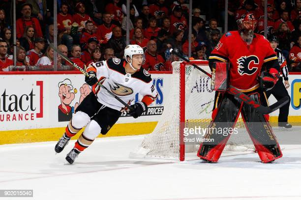 Mike Smith of the Calgary Flames skates against Brandon Montour of the Anaheim Ducks during an NHL game on January 6 2018 at the Scotiabank...
