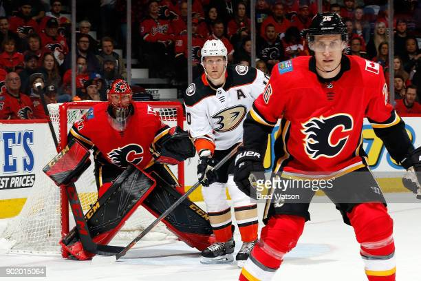 Mike Smith of the Calgary Flames skates against Corey Perry of the Anaheim Ducks during an NHL game on January 6 2018 at the Scotiabank Saddledome in...