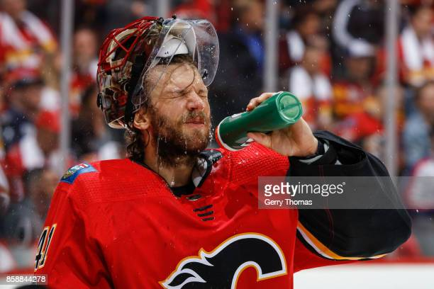Mike Smith of the Calgary Flames takes a break in an NHL game against the Winnipeg Jets at the Scotiabank Saddledome on October 07 2017 in Calgary...