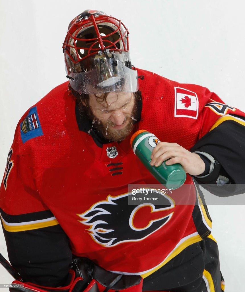 Mike Smith #41 of the Calgary Flames takes a water break against the Edmonton Oilers at Scotiabank Saddledome on March 13, 2018 in Calgary, Alberta, Canada.