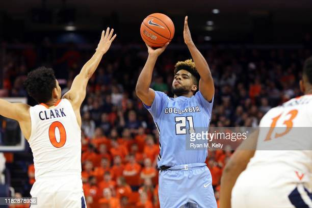 Mike Smith of the Columbia Lions shoots over Kihei Clark of the Virginia Cavaliers in the first half during a game at John Paul Jones Arena on...